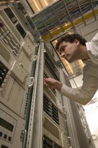 Computer Technician Examining Server